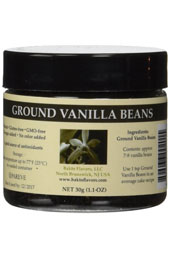 round container of ground vanilla beans