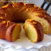orange bundt cake sliced on a plate