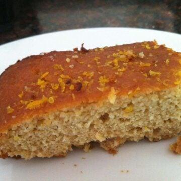 close up of a piece of paleo orange cake on white plate