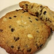 close up of two large paleo cookies with cacao nibs and macadamia and coconut