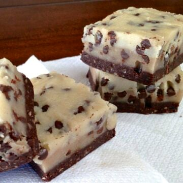 four square pieces of raw no bake chocolate chip cookie dough brownies on white napkin