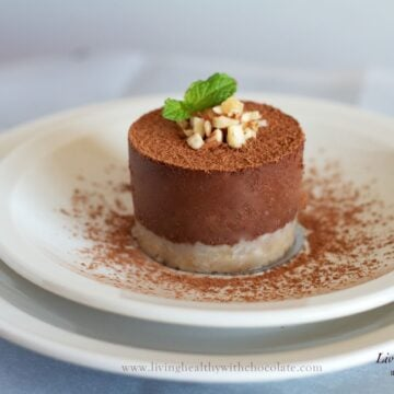 single serving of paleo chocolate pie dusted in cacao powder topped with chopped nuts and fresh mint
