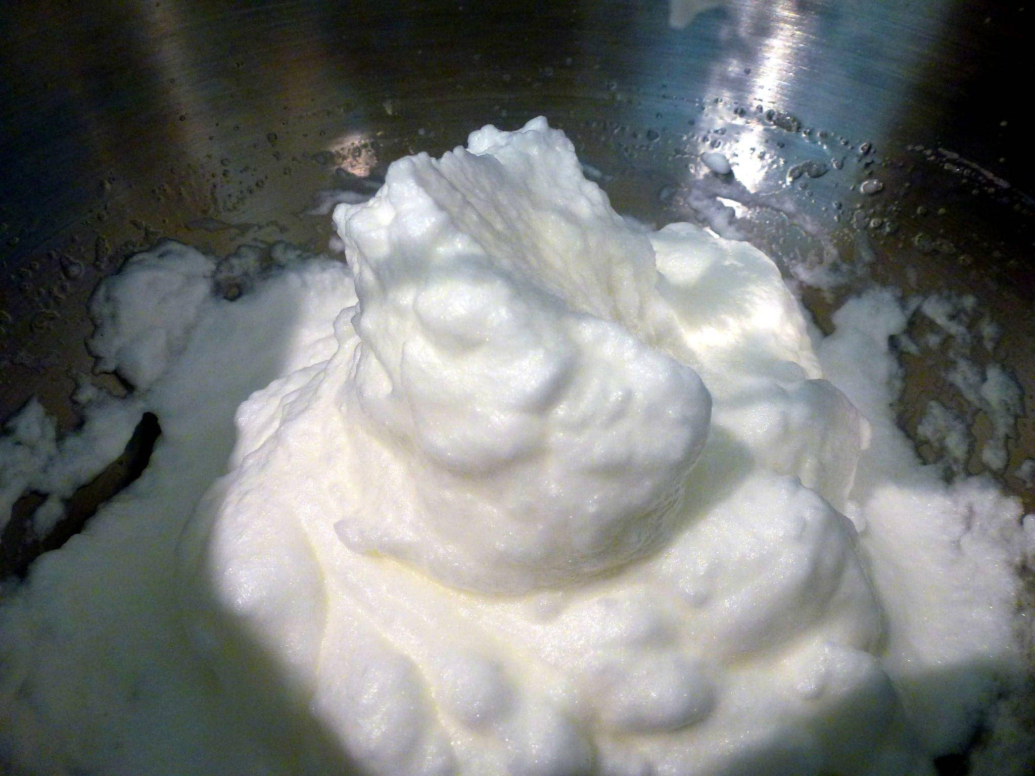 close up of whipped cream for the top of a paleo strawberry almond cupcake