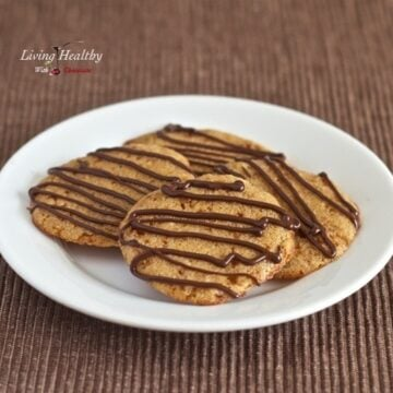 round plate with four paleo soft and chewy butter cookies drizzled with chocolate