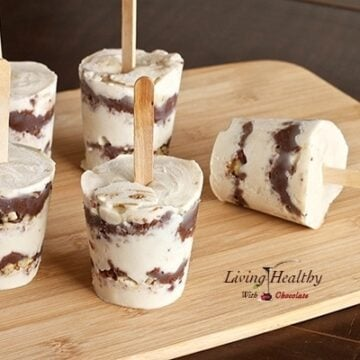 paleo nutella layered ice cream pops with popsicle stick on wooden table