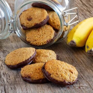 glass jar on its side filled with banana cinnamon cookies