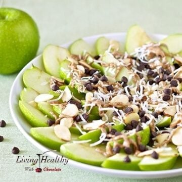 close up of a plate of apple nachos for dessert topped with chocolate and shredded coconut and sliced almonds