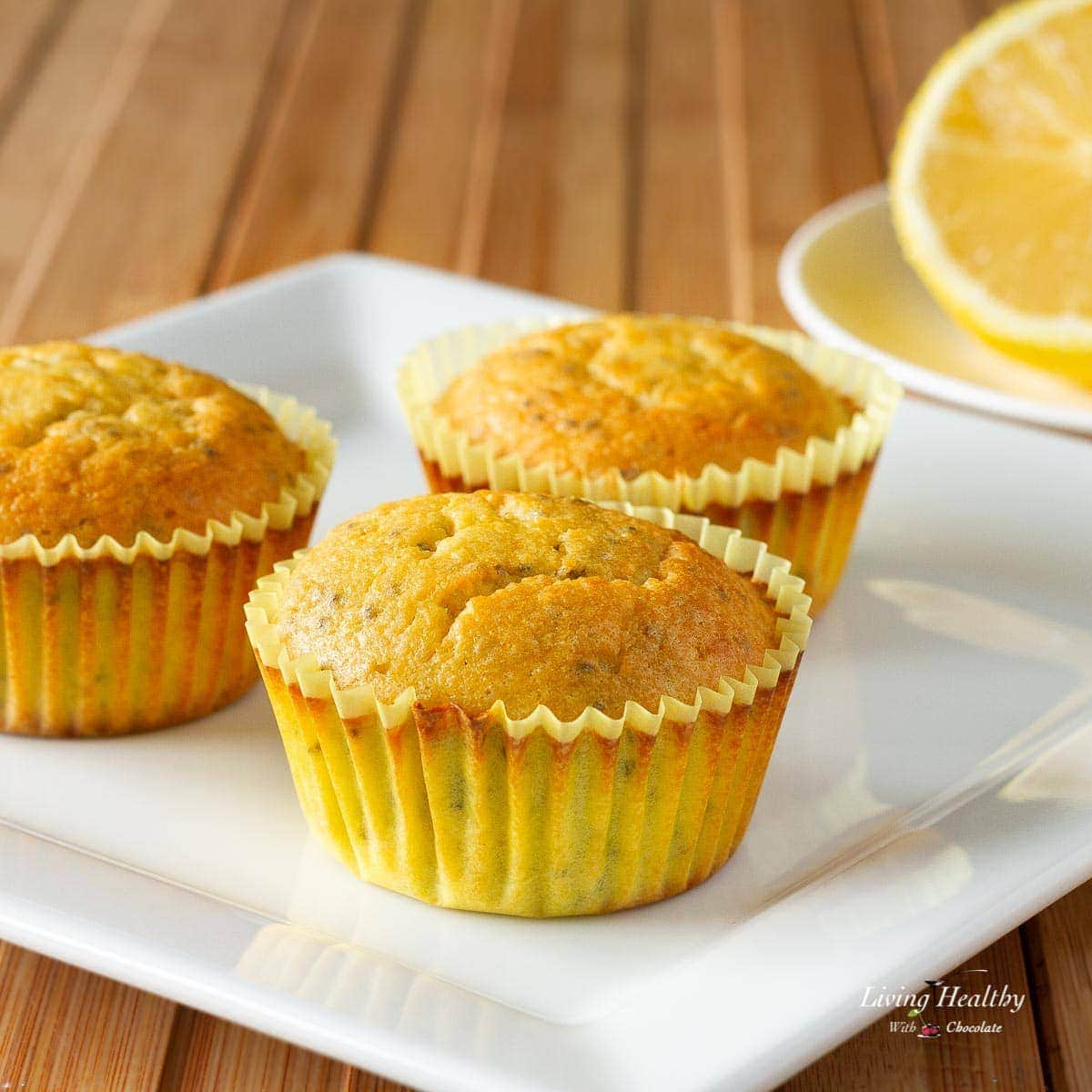 three lemon chia seed muffins on a white plate