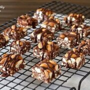 rows of paleo dark chocolate granola crunch bar squares cooling on a wire rack