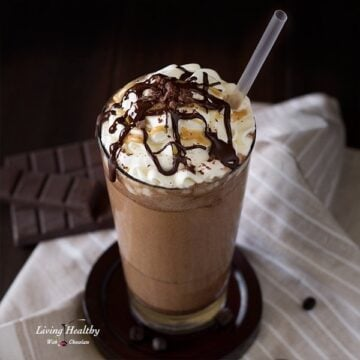 large cup of healthy paleo copy cat Starbucks Mocha Frappuccino topped with whipped cream chocolate and caramel