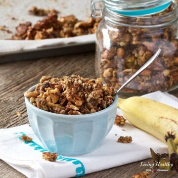 bowl of banana granola with jar of granola in background and banana on right side of bowl