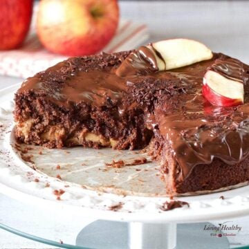 Apple chocolate cake topped with slices of apple and drizzled in chocolate sauce