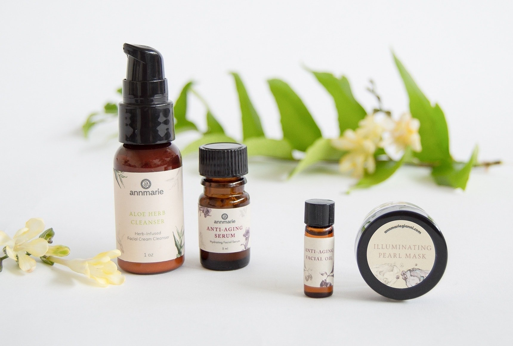four safer skincare products on a table with a green leaf in the background
