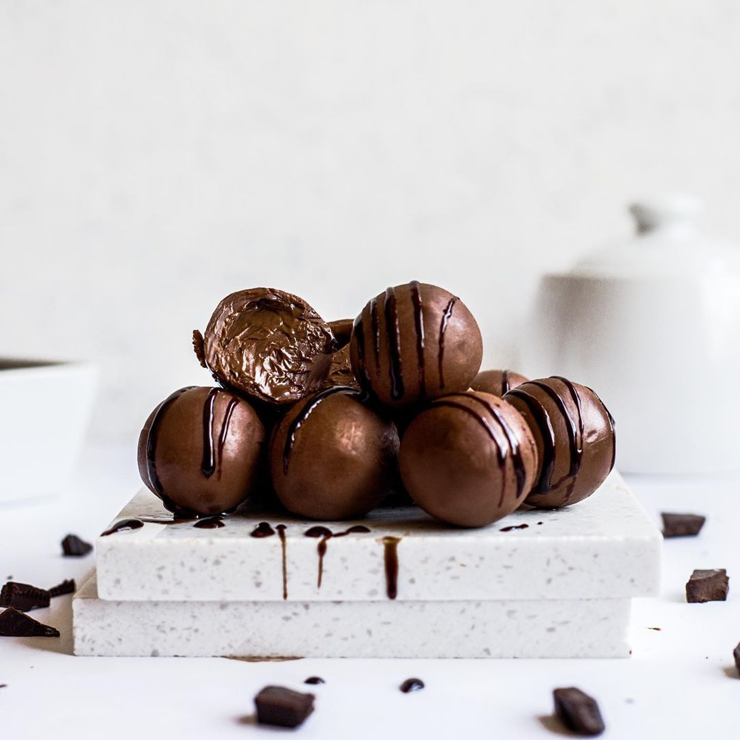 stack of chocolate hazelnut cream filled truffles with a white background