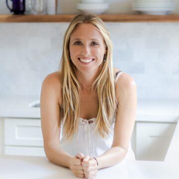 Headshot of Adriana Harlan in her kitchen