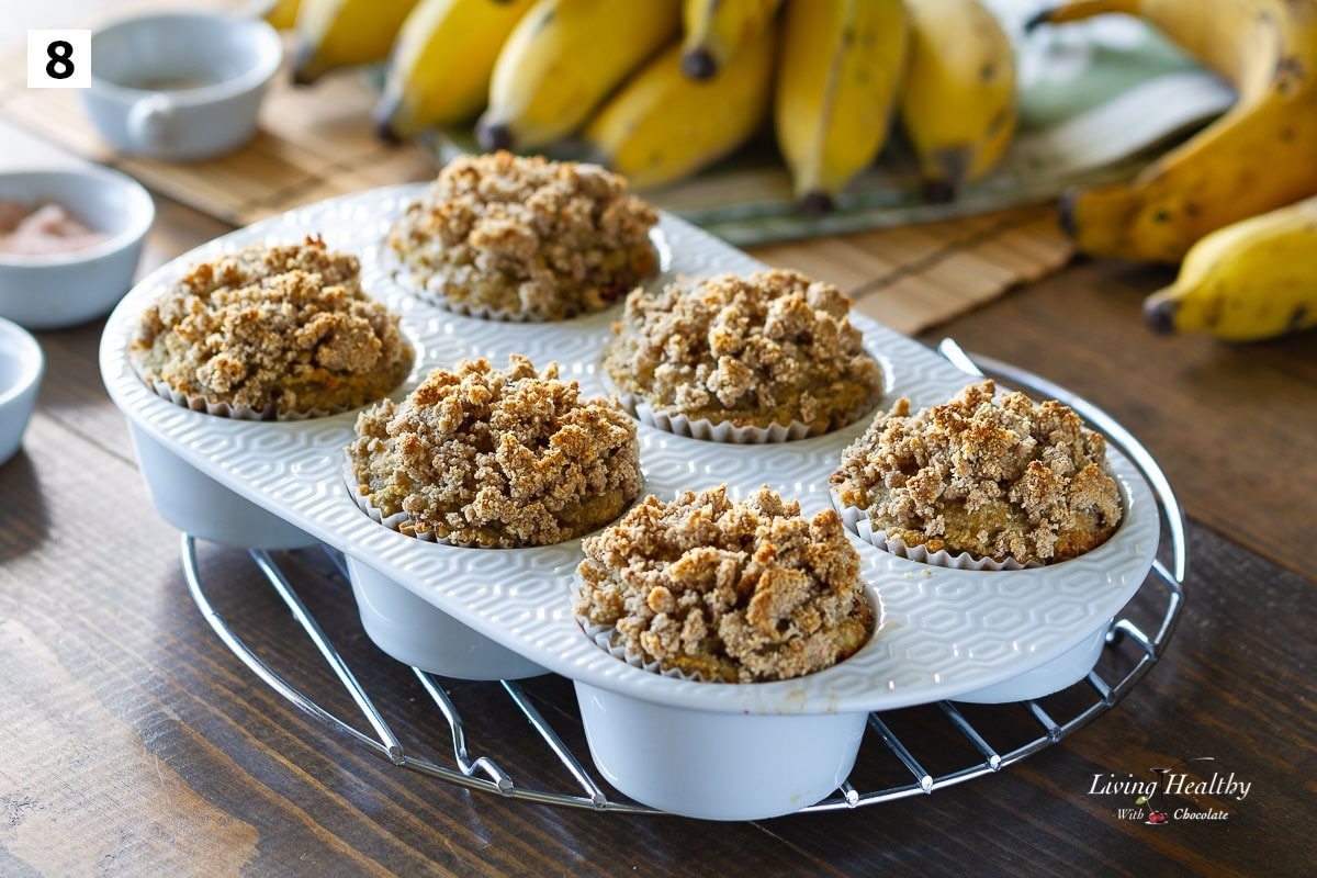 banana crumb muffins in white ceramic muffin pan cooling on a wire rack