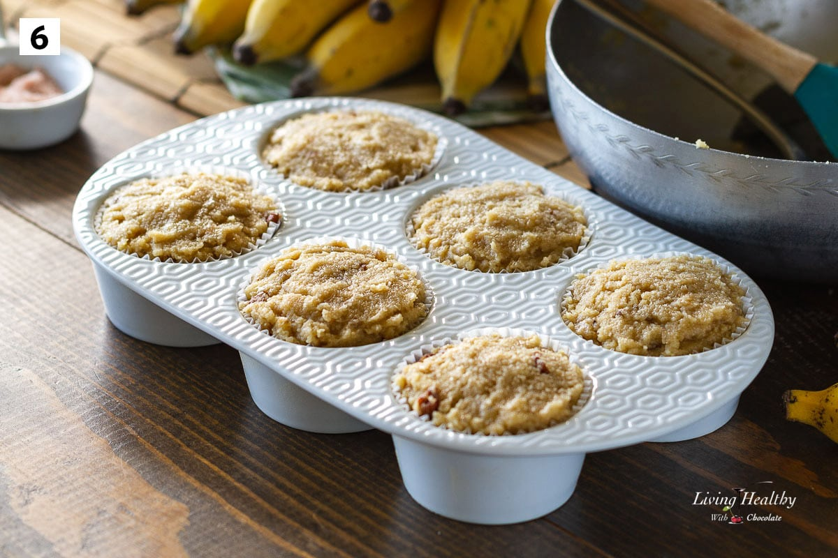 6 cups white ceramic muffin pan filled with batter to the top