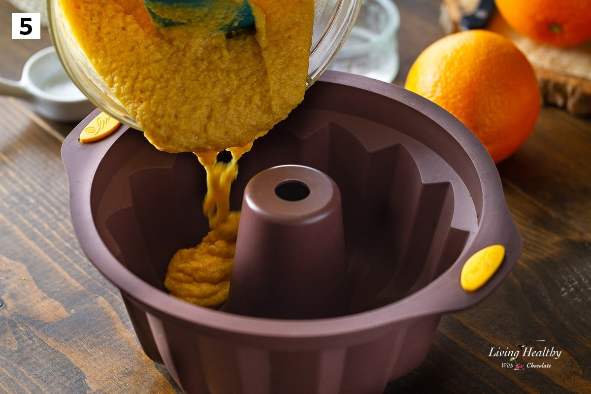 batter being poured in a brown silicone bundt pan